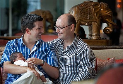 In the name of the fathers ... John Allen-Drury, left, and his partner, Darren, nurse their son, Noah, who was born in India using a surrogate mother.
