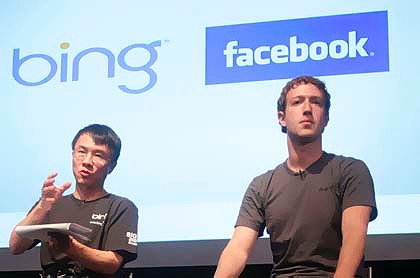Microsoft Online Services Division president Qi Lu, left, and Facebook founder Mark Zuckerberg, speak in the Galileo Auditorium on Microsoft's Silicon Valley Campus in Mountain View.
