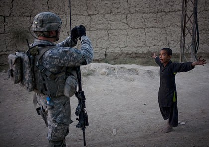 Say cheese ... A US soldier captures the day-to-day moments of his work during a patrol in Kandahar City.