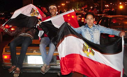Protesters celebrate Mubarak's resignation in the Egyptian city of Alexandria.