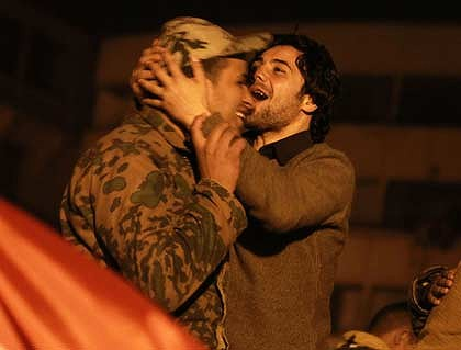 A protester kisses a soldier at Cairo's Tahrir Square after Mubarak's resignation.