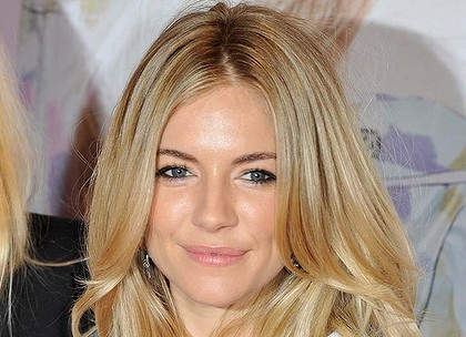 Sienna Miller ... $153,000 in legal fees and damages.