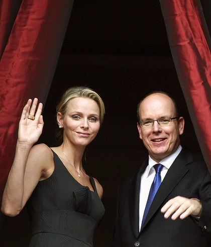 Prince Albert II and Charlene Wittstock observe Monaco's parade honouring St Jean.