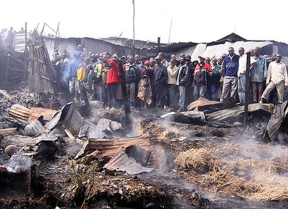 No escape ... crowds of people look at the destruction after another pipeline blast in Nairobi claimed the lives of at least 100 people.