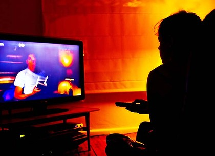 Couch potatoes ... television watching has barely dropped, according to research.