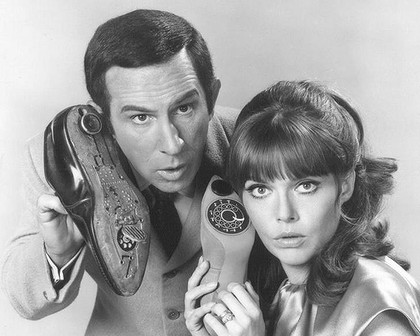 Agent 86, Agent 99 and their unreliable shoe phones in <i>Get Smart</i>.