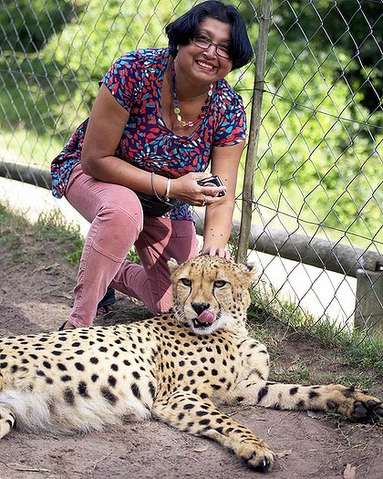 Violet plays with the 'tame' cheetah at the private Kragga Kamma game reserve near Port Elizabeth.