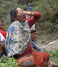 A woman breaks down with her son as the search for her missing husband continue.