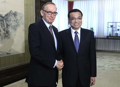 Chinese Vice Premier Li Keqiang (R) shakes hands with Australian Foreign Minister Bob Carr during a meeting at the Zhongnanhai leadership compound in Beijing, May 15, 2012. REUTERS/China Daily (CHINA - Tags: POLITICS) CHINA OUT. NO COMMERCIAL OR EDITORIAL SALES IN CHINA
