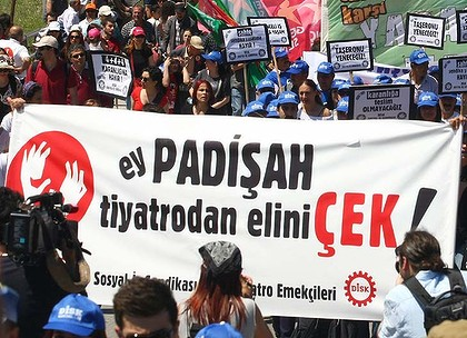 "This picture taken on May 1, 2012 shows artists displaying a banner which translates as ""Hey Sultan, take your hands off theatre, "" during a demonstration against a government bid to privatise state-funded theatres in Ankara.  Turkey's Islamist rooted government's bid to privatise state-funded theatres sparked fury among secular-minded artists who denounced the move as ""death warrant"" for arts. Prime Minister Recep Tayyip Erdogan has threatened to privatise state-funded theaters by saying: ""Theatres are not in the hands of the state in almost any developed country."" AFP PHOTO/ADEM ALTAN"