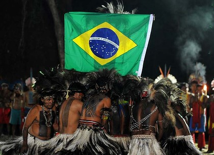 Terena indians dance around a Brazilian national flag during the opening of the Green Games as part of the UN Rio+20 environmental summit.