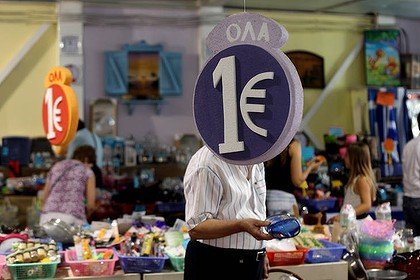 "Customers browse through discounted goods at a ""one euro store""  in Athens."