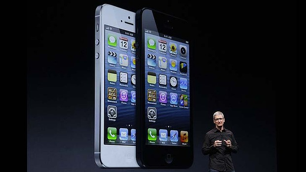 The big reveal ... Apple CEO Tim Cook shows off the iPhone 5.