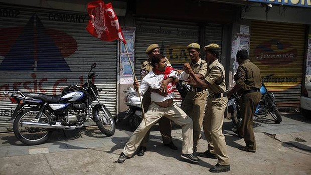 Angry demonstrators disrupted trains and forced some shops and schools to close in a partly successful national strike protesting a government decision to cut fuel subsidies and open India's huge retail market to foreign companies.