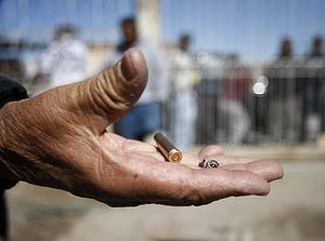 Ciudad Juarez ... a bullet casing at the scene of a shooting where three girls, aged 12, 14 and 15, were killed.