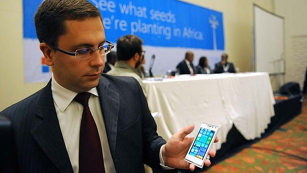 Microsoft's Gustavo Fuchs shows off the Huawei 4Afrika, a full functionality Windows Phone 8 pre-loaded with select applications designed for Afric.