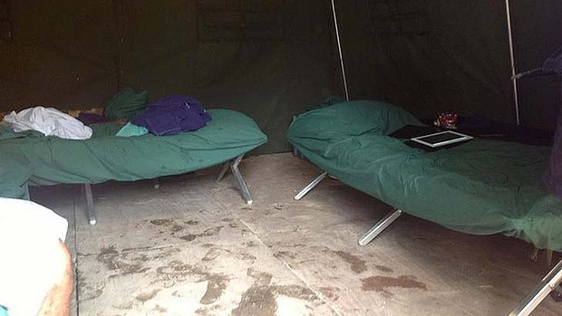 Photos smuggled out of the Manus Island show the conditions at island's processing camp.