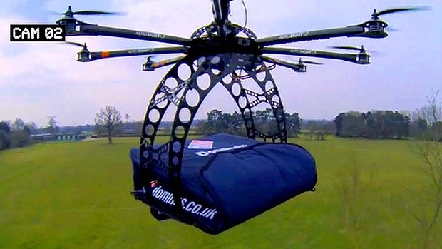 """DomiCopter"": Domino's octocopter drone can fly up to two large pizzas to customers."