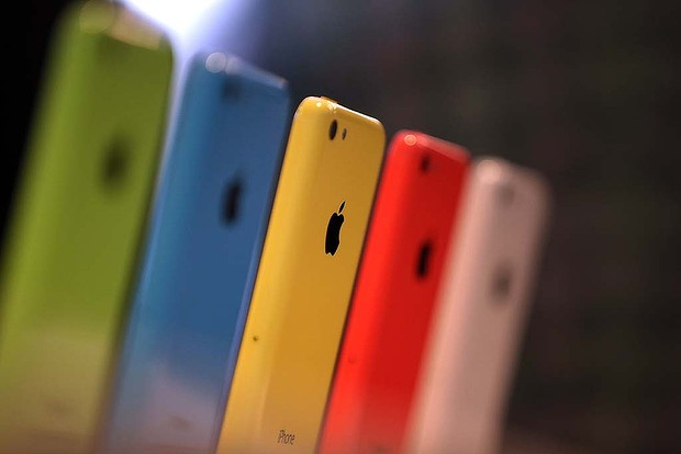 The iPhone 5c in green, blue, yellow, pink and white.