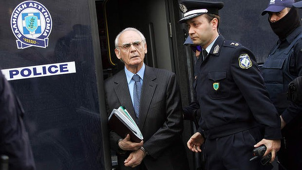 Greek former defence minister, Akis Tsohatzopoulos, arriving for a court trial in Athens. A Greek court found Akis Tsohatzopoulos guilty of money laundering in a six-million euro case that has become emblematic of political corruption in the debt-wracked country, on October 7, 2013.