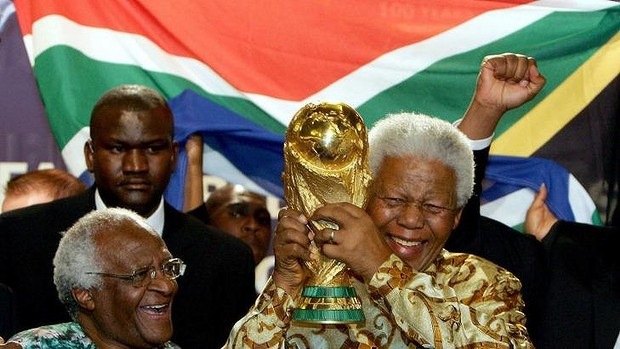 Nelson Mandela holding the soccer World cup beside Capetown Archbishop Desmond Tutu.