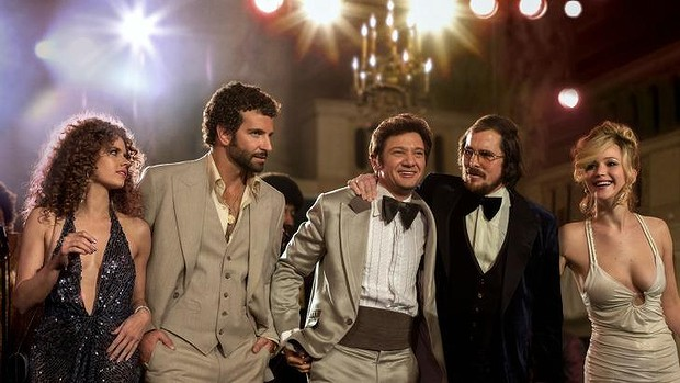 "Already getting Oscars buzz ... From left, Amy Adams, Bradley Cooper, Jeremy Renner, Christian Bale and Jennifer Lawrence in a scene from David O. Russell's ""American Hustle,"" which received seven Golden Globe nominations."