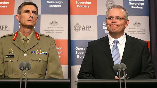 Staying tight lipped over the incursions: Lieutenant-General Angus Campbell, left, and the Immigration Minister Scott Morrison.