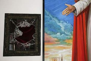 The scene of the crime: Broken glass where the reliquary with the blood of the late Pope John Paul II was located next to a painting of the late Pope.