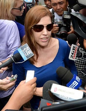 Shapelles sister Mercedes fighting her way through the media pack after visiting Shapelle.