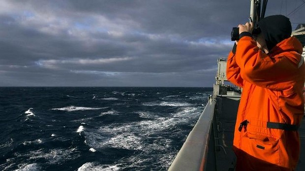 Able Seaman Marine Technician Matthew Oxley stands aboard the Australian Navy ship the HMAS Success looking for debris in the southern Indian Ocean during the search for missing Malaysian Airlines Flight MH370.