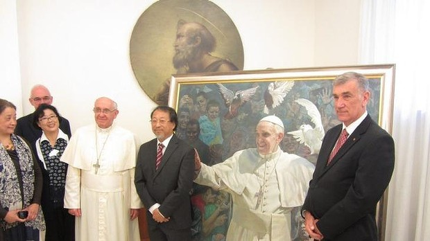 Inspired by forgiveness: Bundeena artist Jiawei Shen, centre, with Pope Francis and Australian Senate president John Hogg.