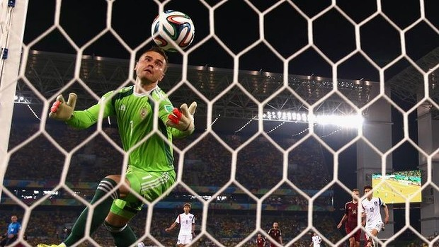 Horror gaffe: Igor Akinfeev of Russia fails to save a shot by Lee Keun-Ho.
