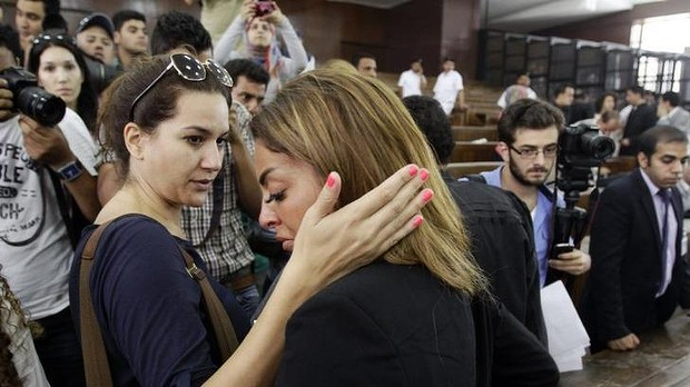 The fiancee of journalist Mohamed Fahmy is consoled by a friend following the verdicts in the sentencing hearing for al-Jazeera journalists.