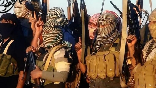 An image grab taken from a propaganda video uploaded by the jihadist group the Islamic State of Iraq and the Levant (ISIL) allegedly shows ISIL militants near the central Iraqi city of Tikrit.