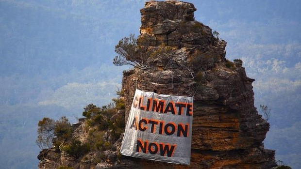 One sister's opinion: a banner hung by climate activists in the Blue Mountains on Sunday.