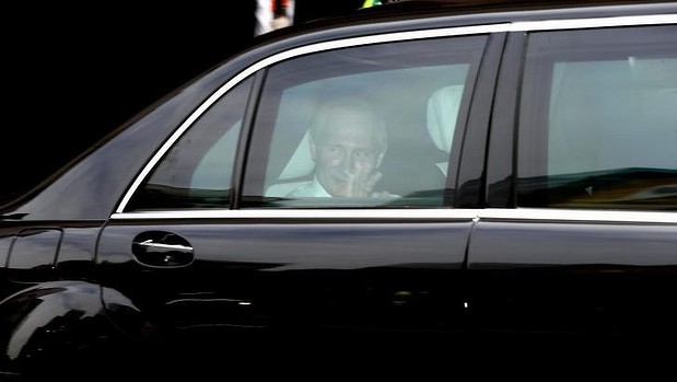 Heading off: Vladimir Putin departs the Hilton Hotel after his G20 visit to Brisbane.