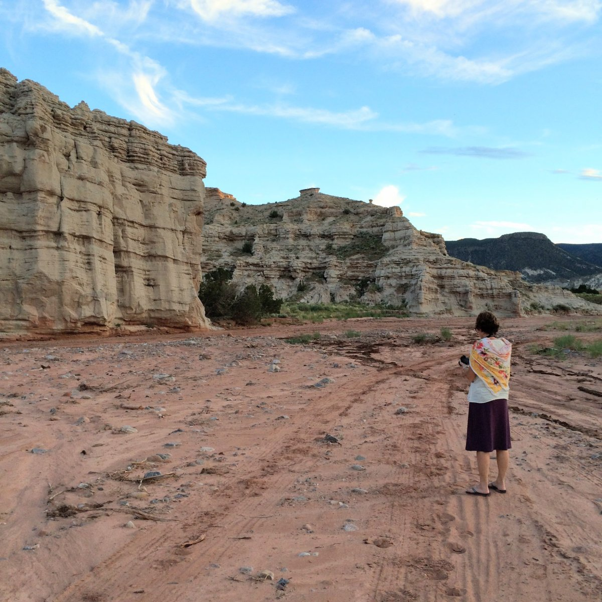 Cheryl takes a photo of an incredible rock formation near Abiquiu.