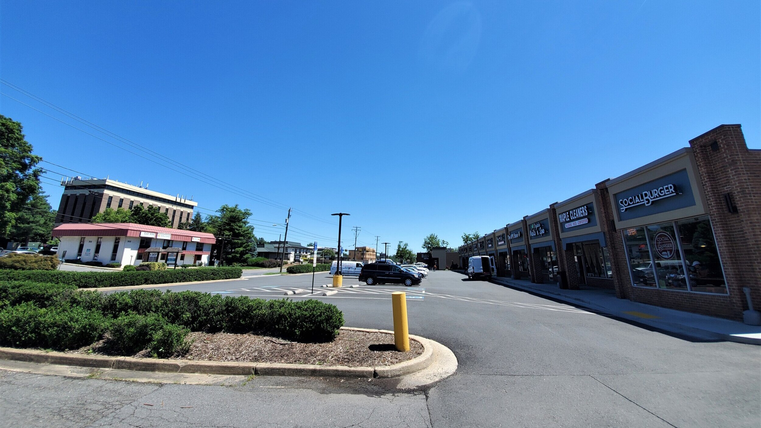 A typical Maple Avenue strip mall, with a narrow front parking lot.