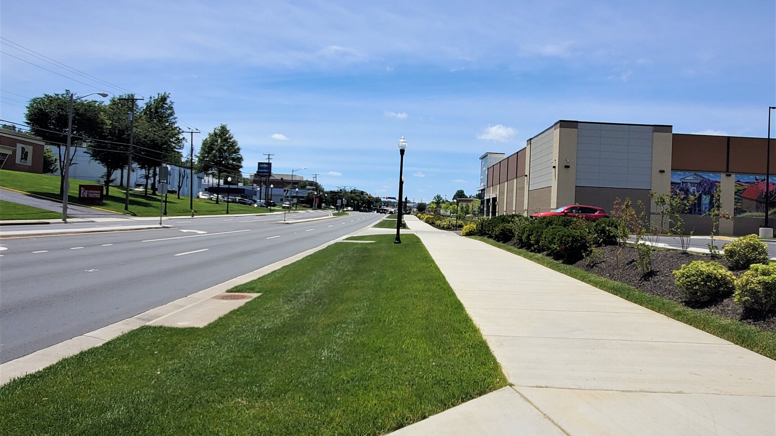 One of two very recent sidewalk segments in front of new developments. It may look similar from the road, but the additional buffer produces a much improved pedestrian experience.
