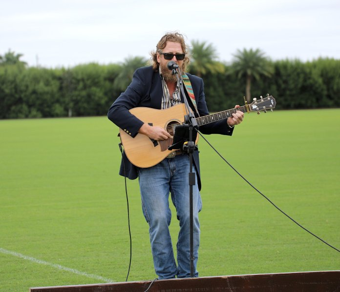 Tom Blake singing a soulful rendition of the National Anthem.