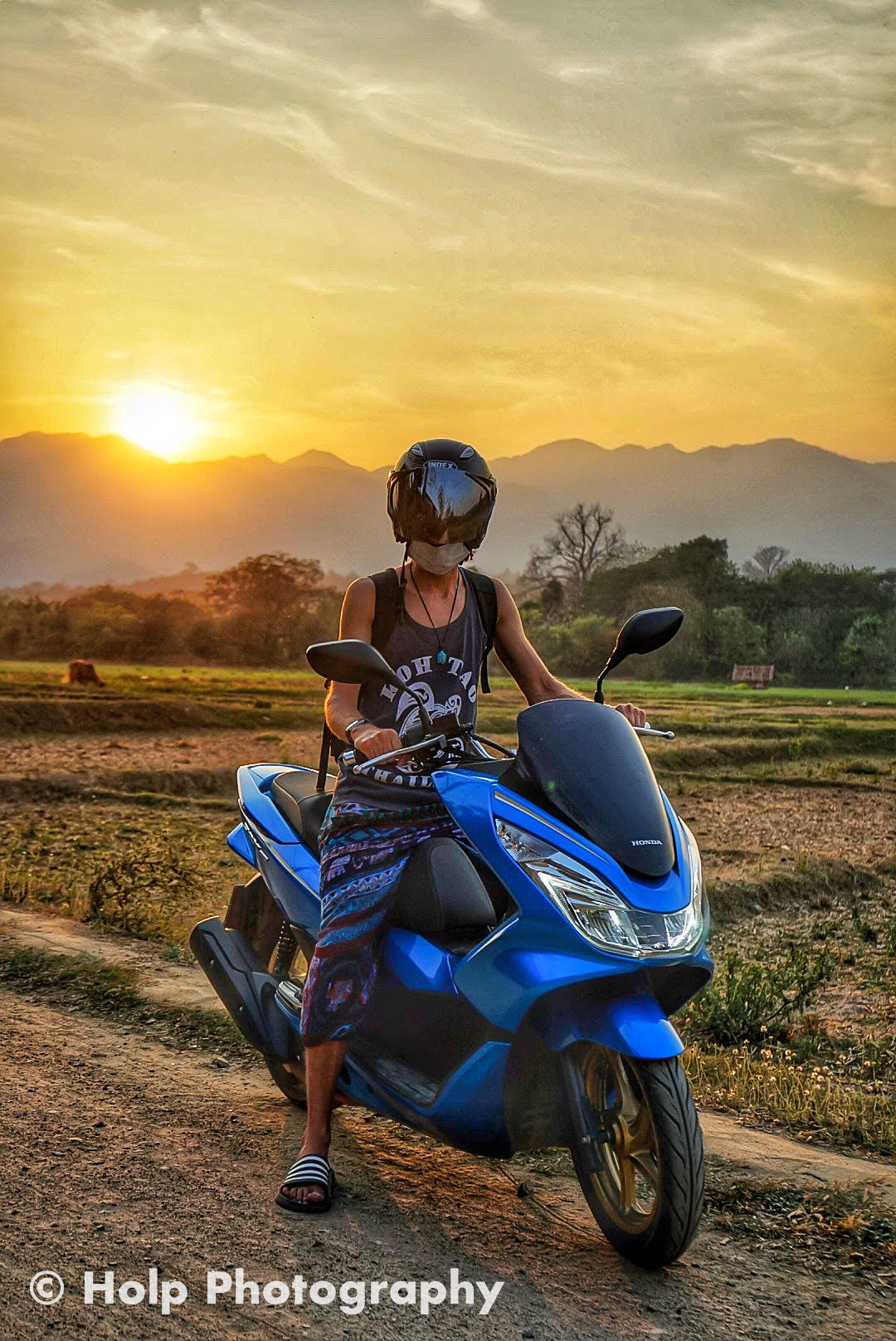 Photo of me and Honda PCX motorbike during sunset in Pai, Thailand.