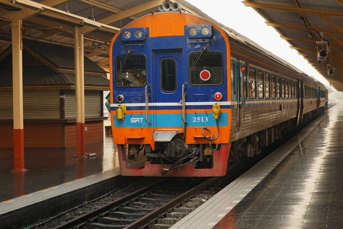 Train to Bangkok pulling into station in Chiang Mai, Thailand.