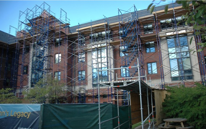 Scaffolding is seen outside of a South Campus residence hall on Thursday, Aug. 27, 2015. (Amar Batra/The Daily Campus)