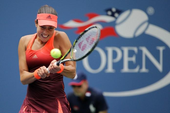 Ana Ivanovic, of Serbia, returns a shot to Dominika Cibulkova, of Slovakia, during the first round of the U.S. Open tennis tournament, Monday, Aug. 31, 2015, in New York. (Matt Rourke/AP)