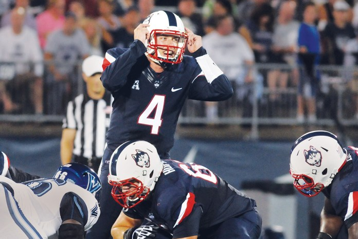 UConn football quarterback Bryant Shirreffs signals at the line of scrimmage during the Huskies' season-opening game against Villanova at Pratt & Whitney Stadium at Rentschler Field in East Hartford, Connecticut on Sept. 3, 2015. (Ashley Maher/The Daily Campus)