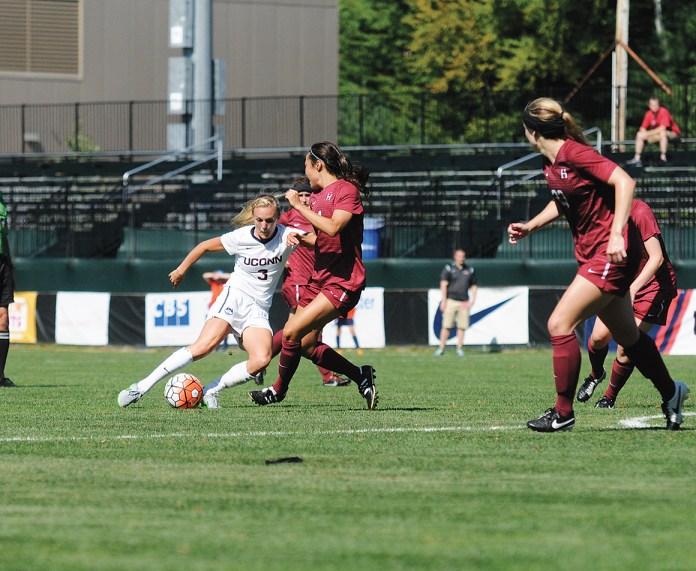 UConn women's soccer forward Rachel Hill (3) dribbles past a Harvard defender during the Huskies' game at Joseph J. Morrone Stadium on Sunday, Sept. 6, 2015. (Amar Batra/The Daily Campus)