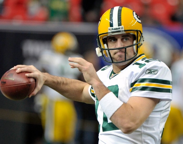 In this Nov. 28, 2010 file photo, Green Bay Packers quarterback Aaron Rodgers (12) warms-up prior to a NFL football game at the Georgia Dome in Atlanta. The Packers have been as steady of a franchise as there is with nine of the 13 division titles since the NFC North was formed in the league's latest realignment in 2002. (John Bazemore/AP)