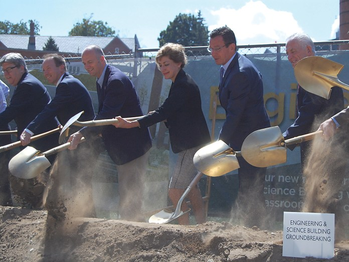 (Middle, L-to-R) State Rep. Gregg Haddad (D-Mansfield), UConn president Susan Herbst,Connecticut Gov. Dannel P. Malloy and other officials break ground on the university's new engineering building in Storrs on Wednesday, Sept. 9, 2015. (Ashley Maher/The Daily Campus)