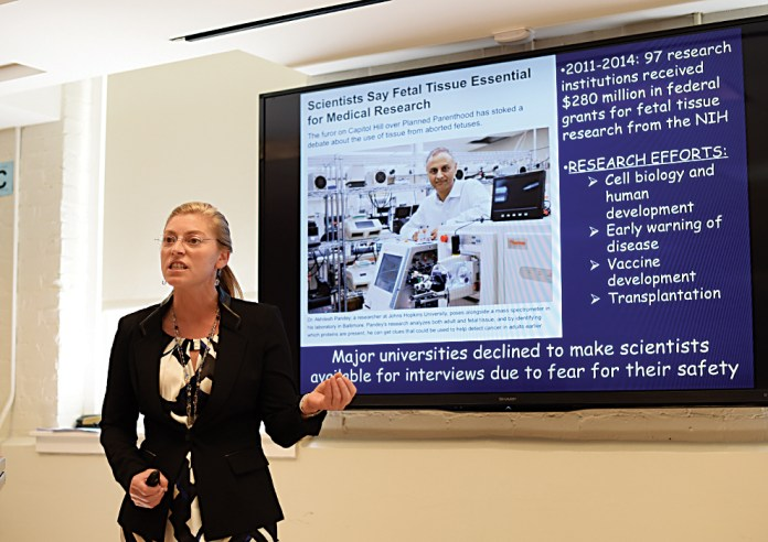 """UConn biology professor Colleen Spurling speaks during her lecture,""""What do you Study? Communicating STEM Concepts to a Broad Audience,"""" on Sunday, Sept. 13, 2015. (Allan Lang/The Daily Campus)"""