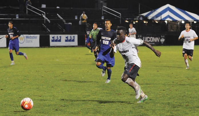 UConn freshman forward Abdou Mbacke Thiam dribbles downfield during the Huskies' game against UC Santa Barbara at Joseph J. Morrone Stadium on Sunday, Sept. 13, 2015. Thiam, a Senegal native, scored a pair of goals in the game. (Amar Batra/The Daily Campus)